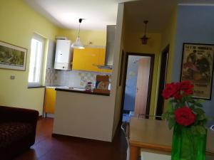 Cucina o angolo cottura di Casa Vacanze Le Coccinelle