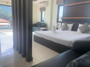 A bed or beds in a room at Villa Freedom