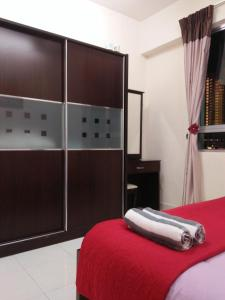 A bed or beds in a room at Lavender Homestay Penang