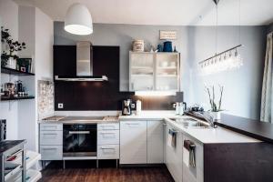 Küche/Küchenzeile in der Unterkunft Ferienwohnung Stadtplatz 25