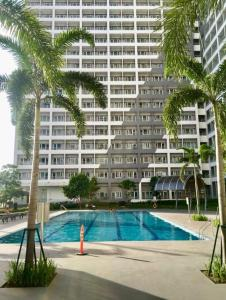 The swimming pool at or near marcelin's Place Tower 2 at Grace Resindeces Taguig