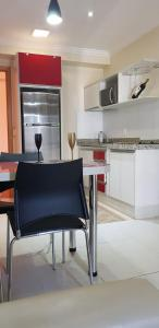 A kitchen or kitchenette at Apartamento Giardino Rio Quente