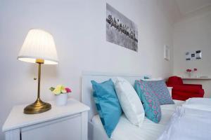 Ein Bett oder Betten in einem Zimmer der Unterkunft Adela Apartment Prague Center
