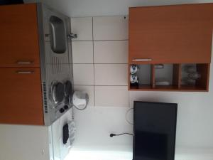 Телевизор и/или развлекательный центр в Apartments Budva Center