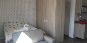 A bed or beds in a room at Sky Brigadeiro Tobias