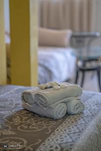 מיטה או מיטות בחדר ב-קלאסיק אין
