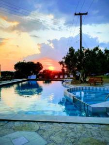 The swimming pool at or close to Asteris Village