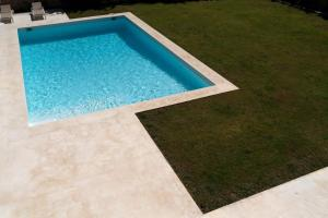 The swimming pool at or near OM VILLA