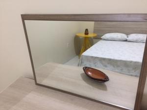 Een bed of bedden in een kamer bij CENTRO DE BELÉM-PA PERTO DA PRAÇA BATISTA CAMPOS