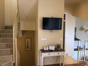 A television and/or entertainment center at Life Apartments San Vicente