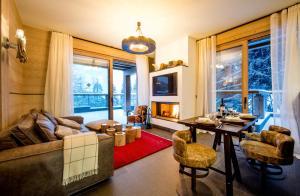Area soggiorno di Chalet Migui Luxury Living & Spa *****, Crans Montana