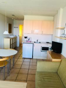 A kitchen or kitchenette at Stammershalle Apartments