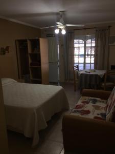 A bed or beds in a room at Brisa Termal