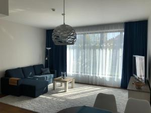 Гостиная зона в Jõe Apartments