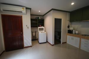 Majoituspaikan KD Residence keittiö tai keittotila