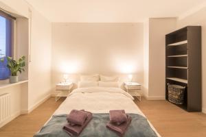 Ein Bett oder Betten in einem Zimmer der Unterkunft ☆ Moderne 90m² 3-Zimmer im Zentrum mit Netflix