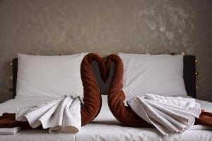 Кровать или кровати в номере Aurellia Serviced Apartments