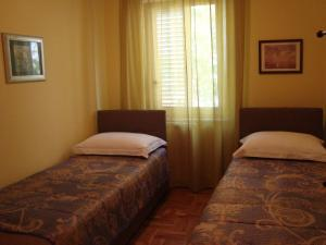 A bed or beds in a room at Apartments Eja