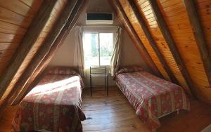 Una cama o camas en una habitación de Villa del Sol Alvear