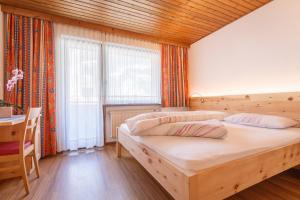 Letto o letti in una camera di Residence Silvia