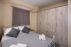 Ένα ή περισσότερα κρεβάτια σε δωμάτιο στο Ifi Sea House