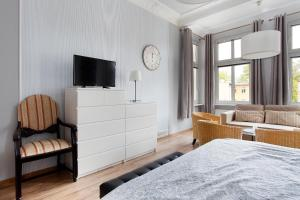 A television and/or entertainment center at Sopockie Apartamenty - Studio 2