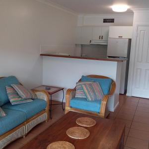 A seating area at The York Beachfront Holiday Apartments