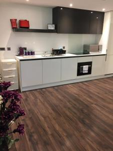 A kitchen or kitchenette at Smart Stays Boutique Apartments
