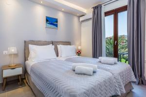 A bed or beds in a room at Olia Green Residence