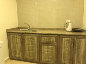 A kitchen or kitchenette at Sultan Home