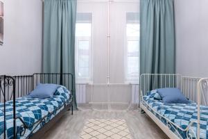 Кровать или кровати в номере улица Чайковского 15
