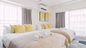 Un ou plusieurs lits dans un hébergement de l'établissement Evergreen Hotel UENO