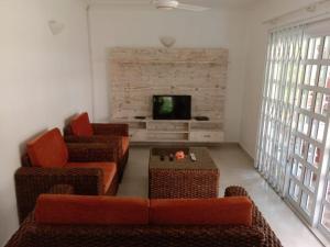 O zonă de relaxare la Beau Vallon Villa Apartments