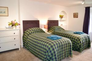A bed or beds in a room at Caliburn