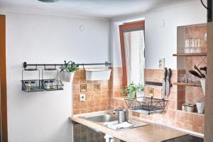 Kuchyňa alebo kuchynka v ubytovaní u Jaňola