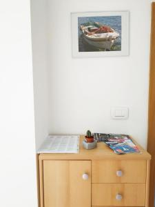 A television and/or entertainment center at Sea view Apartments Javor