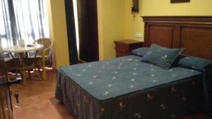 A bed or beds in a room at Apartamentos la Atarraya