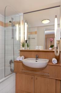 Ванная комната в Citadines Kurfürstendamm Berlin Aparthotel