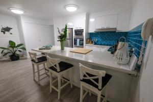 A kitchen or kitchenette at Sanctuary Beach Retreat