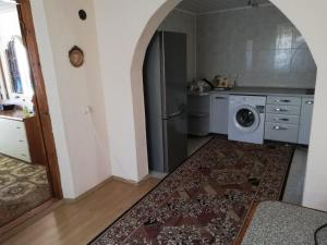 A kitchen or kitchenette at Cozy house in the center of Balti city