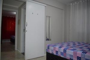 A bed or beds in a room at Apartamento Mar Vermelho