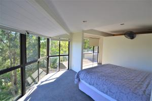 A bed or beds in a room at Currumbin Tree Place