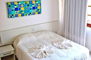 A bed or beds in a room at Resid. Moradas de Israel - Tonziro