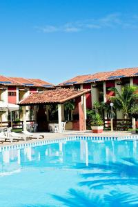 The swimming pool at or near Residencial Jerusalém I - Tonziro