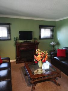 A television and/or entertainment center at Your Oasis in Niagara Falls Canada