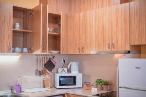 Кухня или кухненски бокс в Апартаменти ТЕИС