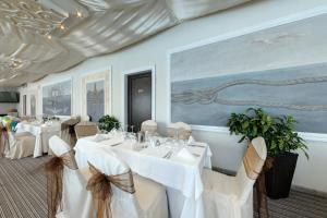 Ресторант или друго място за хранене в Пенелопа Палас Апарт Хотел и СПА