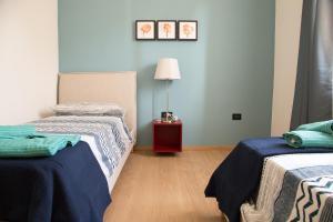 Letto o letti in una camera di Appartamento con giardino Le Querce