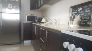 A kitchen or kitchenette at City Apartment- Central Location