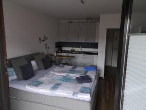 Ein Bett oder Betten in einem Zimmer der Unterkunft Ferienwohnung Hölscher